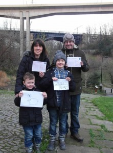 The Blakey family with their postcards to Jenny